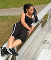 Free Stock Photo: A beautiful African American teen girl resting on bleachers with a bottle of water