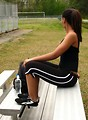 Free Stock Photo: A beautiful African American teen girl sitting on bleachers with a bottle of water