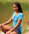 Free Stock Photo: A beautiful African American teen girl posing by a lake