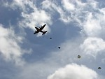 Free Stock Photo: Soldiers parachuting from a C-130 military plane