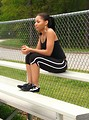Free Stock Photo: A beautiful teen African American girl sitting on bleachers