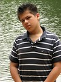 Free Stock Photo: A young latino man posing outdoors by a lake