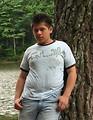 Free Stock Photo: A young latino man posing by a lake