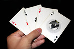 Free Stock Photo: A hand holding the four Aces in a standard deck of cards