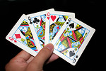 Free Stock Photo: A hand holding the four Queens in a standard deck of cards