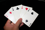 Free Stock Photo: A hand holding the four twos in a standard deck of cards