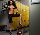 Free Stock Photo: A beautiful girl in a bikini top in a locker room with football gear