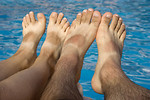 Free Stock Photo: Feet dangling over water