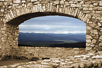 Free Stock Photo: A mountain view through a stone arch