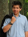 Free Stock Photo: A young latino teen boy posing outdoors by a tree