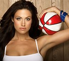 Free Stock Photo: A beautiful woman posing with a basketball