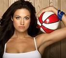 Free Stock Photo: A beautiful woman posing with a basketball
