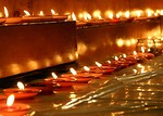 Free Stock Photo: A row of small votive candles burning