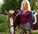 Free Stock Photo: A beautiful blonde posing with a horse