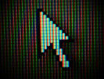 Free Stock Photo: Close-up of a mouse pointer on a computer screen