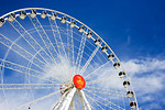 Free Stock Photo: A large ferris wheel with a blue sky background