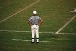 Free Stock Photo: A football referee standing on an empty football field