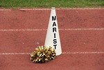 Free Stock Photo: A cheerleader pom pom and megaphone on a track field