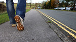 Free Stock Photo: Close-up of feet walking on a road