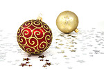 Free Stock Photo: Red and gold Christmas ornaments on a white floor with silver stars