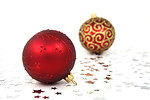 Free Stock Photo: Two red Christmas ornaments on a white floor