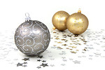 Free Stock Photo: Silver and gold Christmas ornaments with silver stars on a white floor