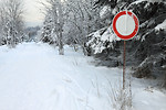 Free Stock Photo: A snow covered path with a no vehicles sign
