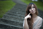 Free Stock Photo: A beautiful Chinese girl sitting on steps making a silly face