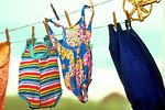 Free Stock Photo: Colorful swimsuits drying on a clothesline