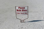 Free Stock Photo: A bike sign on the beach