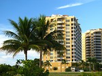 Free Stock Photo: Condos along the ocean with palm trees