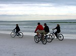 Free Stock Photo: People riding bikes on the beach
